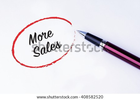 The words More Sales written in a red circle to remind you an important appointment with a pen on isolated white background. New Year concepts of goal and objective. - stock photo