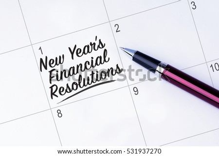 The words New Yearâ??s Financial Resolutions written on a calendar planner to remind you an important appointment with a pen on isolated white background. New Year concepts of goal and objective.