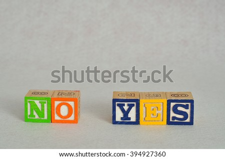 The words no and yes spelled with alphabet blocks isolated on a white background - stock photo