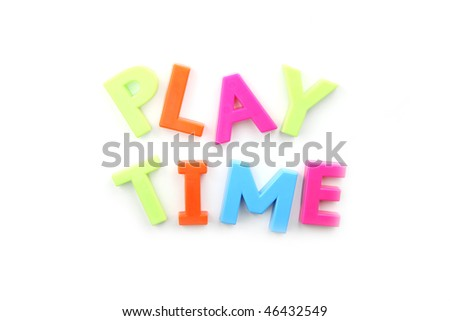 The words 'playtime' spelled out using colored fridge magnets, isolated on white