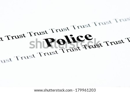 The words Police and Trust printed on a page.