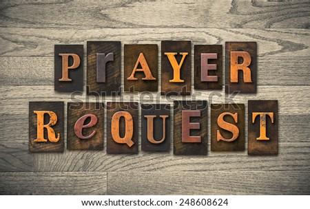 "The words ""PRAYER REQUEST"" written in vintage wooden letterpress type. - stock photo"