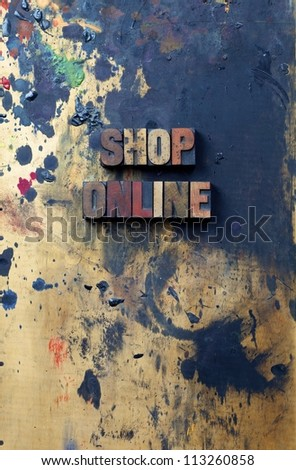 The words shop on-line written in antique letterpress printing blocks. - stock photo