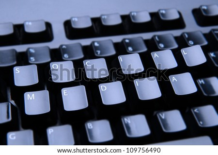 The words Social Media spelled out on a computer keyboard. Only the keys forming Social Media are in focus.