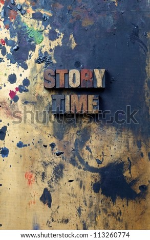 The words story time written in antique letterpress printing blocks. - stock photo