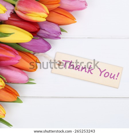 The words Thank You with tulips flowers as a gift