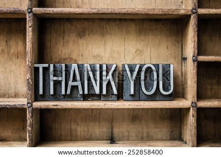 """The words """"THANK YOU"""" written in vintage metal letterpress type sitting in a wooden drawer. - stock photo"""