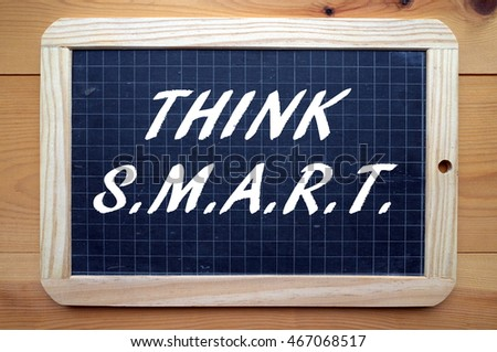 The words Think SMART on a blackboard. The business acronym for project planning and change management that stands for Specific, Measurable,Achievable, Relevant and Time-bound