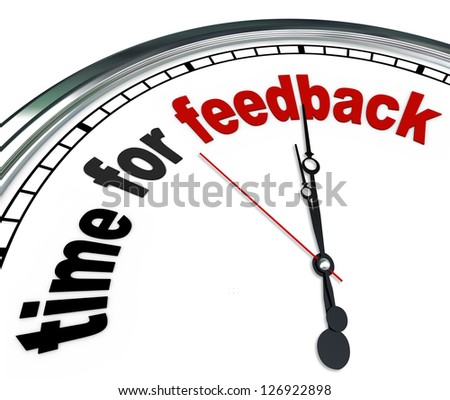 The words Time for Feedback on an ornate white clock, showing that it is time to collect input and responses in a question and answer session during a meeting or other group event - stock photo
