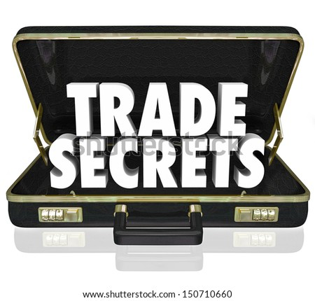 The words Trade Secrets in an opening black leather briefcase to illustrate proprietary information or intellectual property - stock photo