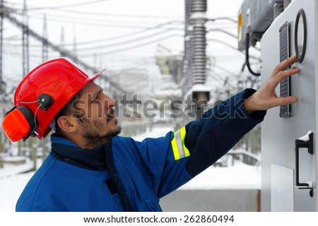 The worker at power plant - stock photo