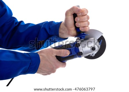 The worker holding angle grinder in his hands isolated on white background.