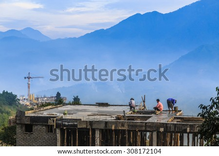 The workers were building a valley.Vietnam - stock photo