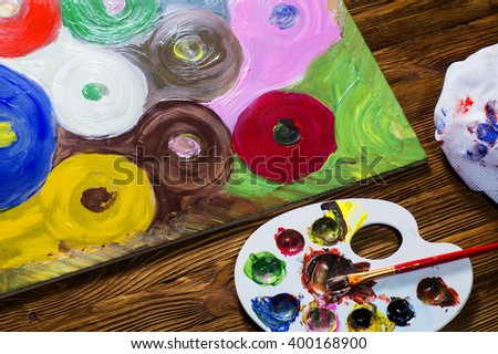 The workplace of the artist, painting picture. Abstract picture painted with acrylic paints. Colorful abstract circles. - stock photo