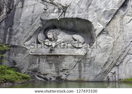 The world-famous monument in Lucerne (Switzerland) - Dying Lion. He carved in the rock at the center of the city of Lucerne (first picture of the animal on the monuments in Europe). - stock photo