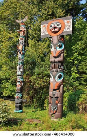 North American Indian Painted Totem Poles Stock Photo