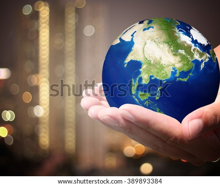 The world is on hold for the city bokeh blur background. earth social in human the hand. Businessman holding planet Earth in palm. Elements of this image furnished by NASA. - stock photo