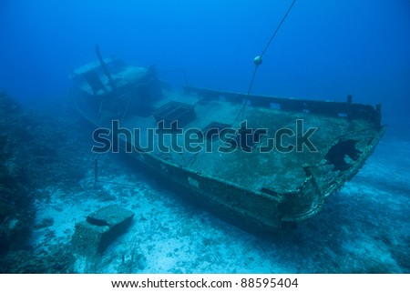The wreck of the Mr. Bud, a former shrimping boat, scuttled off the island of Roatan, Honduras and now used as a scuba diving site. - stock photo