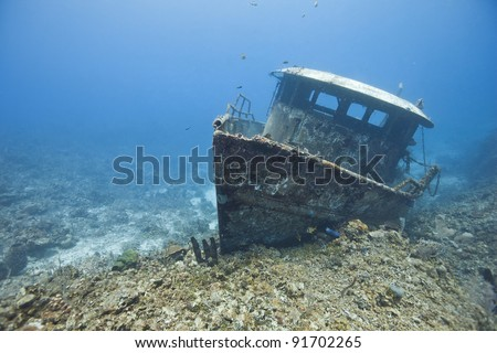 The wreck of the Mr. Bud, a former shrimping boat, scuttled off the island of Roatan, Honduras and now used as a scuba diving site.