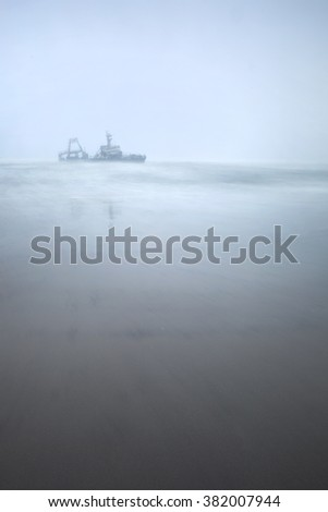 The wreckage of the Zeila on a typical Skeleton Coast day - stock photo