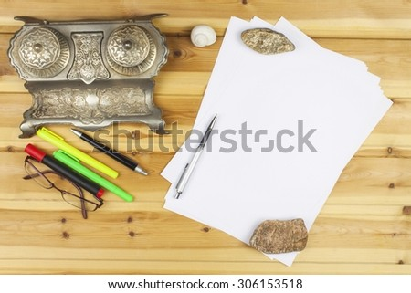 The writer writes a novel. Creating success stories. Pens in the office on a wooden table. Confession of love for Valentine's Day written on by hand on paper. Issues of love and hope. - stock photo