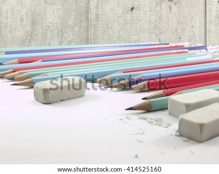 The writing tools on concrete wall background - stock photo