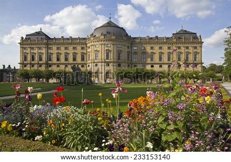 The Wurzburg Residence building and formal garden with flowers in Wurzburg, Germany - stock photo