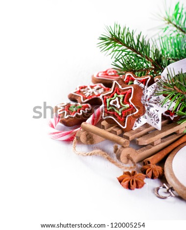 The Xmas background with sled and gingerbread biscuits