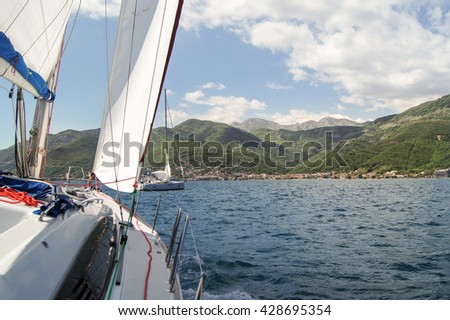 """The yacht is going to roll. Tivat, Montenegro - 26 April, 2016. Regatta """"Russian stream"""" in God-Katorskaya bay of the Adriatic Sea off the coast of Montenegro. - stock photo"""
