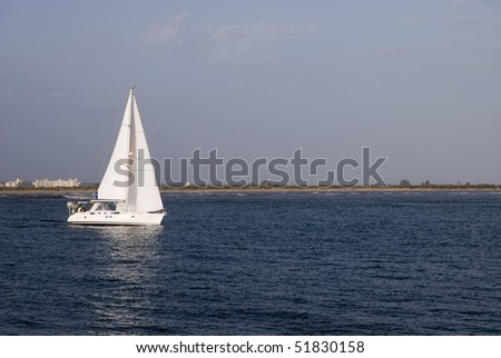 The yacht with sails floating on the river