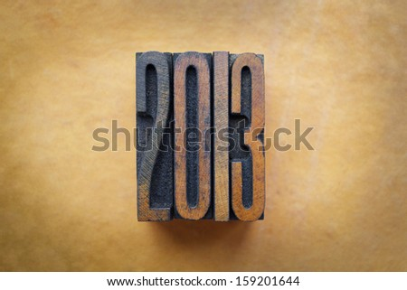 The year 2013 written in vintage letterpress letters. - stock photo