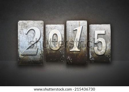 The year 2015 written in vintage letterpress type - stock photo