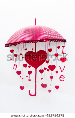 The yellow and red umbrella with heart, The symbol of love.
