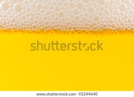 The yellow background - the detail of beer - stock photo