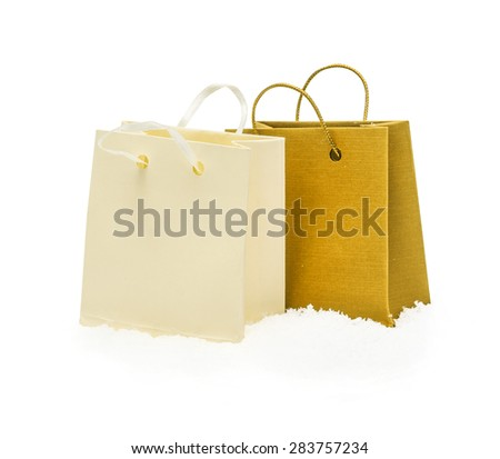 The yellow gift packages stand on snow, isolated on the white - stock photo