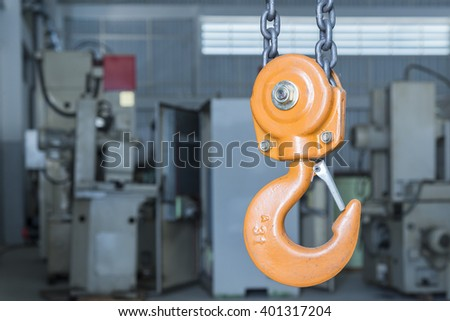 the yellow hook and chain with the factory background - stock photo
