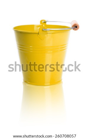 The yellow metal bucket on a white background.