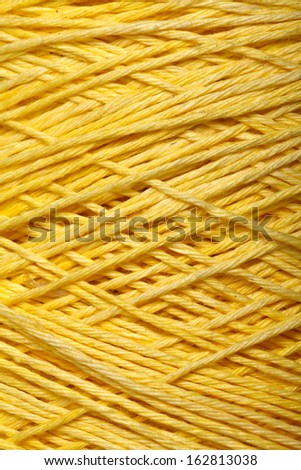 The yellow yarn skein used for knitting clothes - stock photo