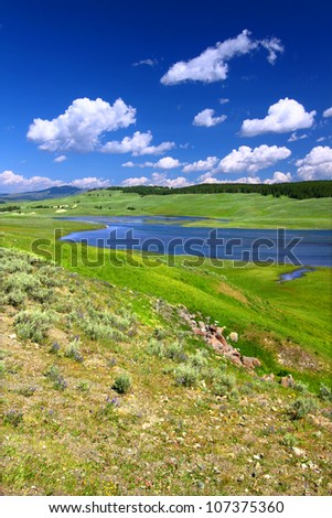 The Yellowstone River flows through Hayden Valley on a gorgeous summer day