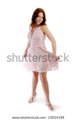 The young attractive redhead woman in pink dress.