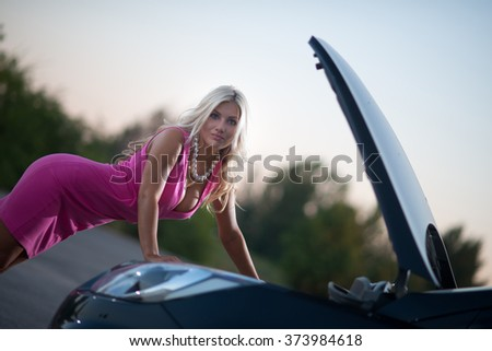 the young attractive woman's car broke down on the road