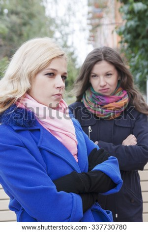 The young beautiful girl has a conflict on the street