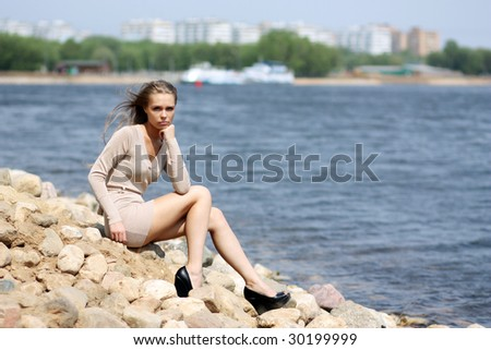 The young beautiful girl has a rest in park