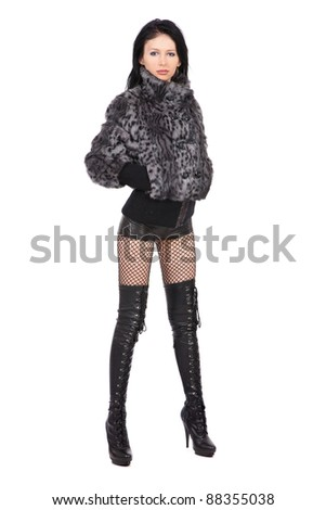 The young beautiful girl in a fur coat  isolated on white - stock photo