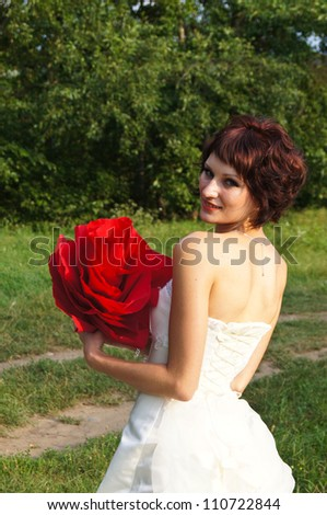 The young beautiful wife in the wedding day