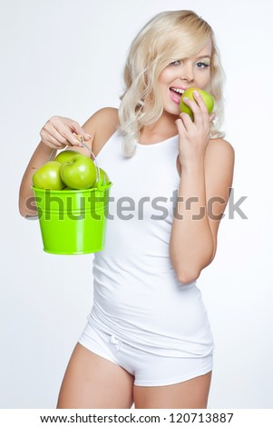 The young beautiful woman with apple