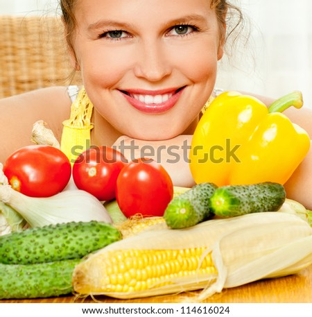 The young beautiful woman with the fresh  and vegetables - stock photo