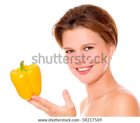 The young beautiful woman with the fresh vegetable, isolated on the white