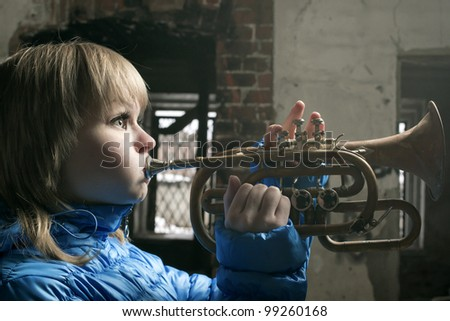The young blonde with wind the tool, Cornet - stock photo
