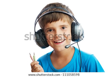 The young boy is listening to music and holding the wire - stock photo